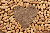 Heart Of  Burlap, Lies On A Background Of Peanut