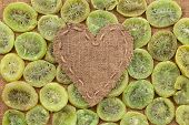 Heart Of  Burlap, Lies On A Background Of Dried Kiwi