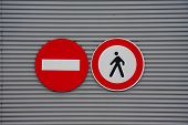 Sign Prohibiting Pedestrian Access On Metal Wall