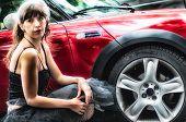 Burlesque Girl Near A Red Car