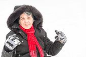 Hispanic Senior Woman Enjoying Her First Snow