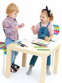 stock photo of montessori school  - Girl and boy sitting at the table draw - JPG
