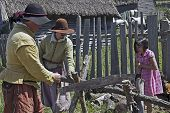 Colonists and a Vistor at Plimoth Plantation
