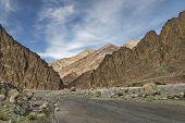 Road Among Majestic Rugged Mountains