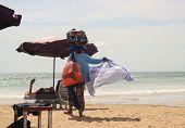 a woman sals scarf on beach at Bali