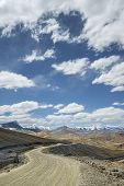 image of manali-leh road  - View Of Curved Road Among Snow Capped Mountains - JPG