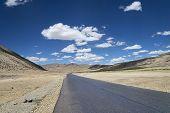 Highway Among High Altitude Flat Plateau