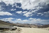 picture of manali-leh road  - View Of Curved Road Among Snow Capped Mountains - JPG