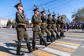 Soldiers of guard of honor march on parade