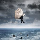 Person Carrying A Brain Above Sea