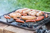 Barbecue With Grilled Sausage On Grill Outdoors