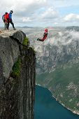 BASE jump off a cliff.