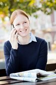 Happy Businesswoman Talking By Phone