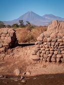 image of conic  - A conical mountain shot through a gap in a wall San Pedro Chile - JPG