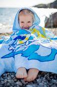 Little Happy Girl In A Towel