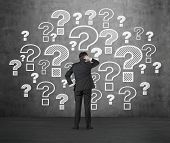 Man Looking To Question Marks