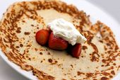 Pancake with whipped cream and strawberries