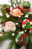 Christmas cupcakes  in the branch of the Christmas tree