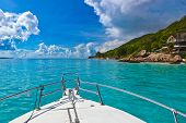Tropical island and boat on Seychelles - vacation background