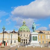 The statue of Amalienborg's founder King Frederick V and Frederik's Church in Copenhagen Denmark.