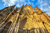 foto of dom  - Facade of the Dom church in the city Cologne lit by evening sun - JPG