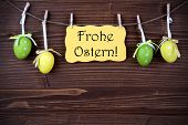 Yellow Label With Four Easter Eggs And Frohe Ostern