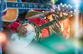 picture of banjo  - colored banjo player in the country band - JPG