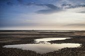 Conceptual Landscape Image Of Two People On Remote Beach