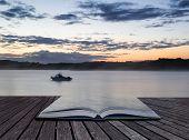 Sunrise Vibrant Landscape Of Boat On Calm Lake Conceptual Book Image