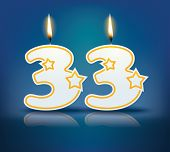 Birthday candle number 33 with flame - eps 10 vector illustration