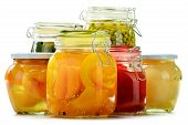 image of pickled vegetables  - Jars with pickled vegetables and fruity compotes isolated on white background. Preserved food