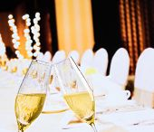 Champagne Flutes With Golden Bubbles On Christmas Table Decoration Background