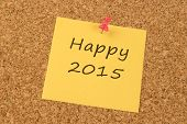 Happy 2015 on a yellow sticky note