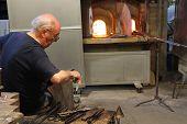 Artisan At Work Making Glass Sculpture