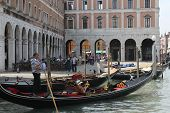 Venice Gondolier Floating On A Traditional Venetian Canal