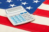 Neat Calculator Over Usa Flag - Accounting Concept