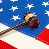 Wooden Judge Gavel Over Us Flag