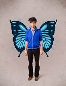 Handsome young man girl with butterfly blue illustration on the back