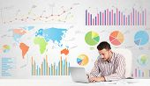 Business man with colorful charts graphs