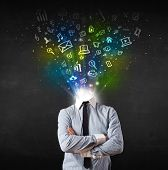 Business man with glowing media icons exploding head concept