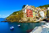 Riomaggiore Village, Rocks And Sea At Sunset. Cinque Terre, Ligury, Italy