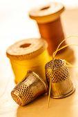 Thread Bobbins And Sewing Thimbles