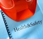 stock photo of personal safety  - Health and safety with red helmet in closeup - JPG