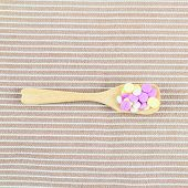 Pills Drug In Wooden Spoon On Brown Cloth