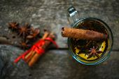 foto of christmas spices  - Christmas time cup of tea with cinnamon and anise spices festive decoration and candles - JPG