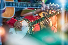 stock photo of banjo  - colored banjo player in the country band - JPG