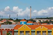 pic of curacao  - Oil refineries in background beyond colorful Curacao resorts - JPG