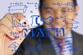 image of mathematics  - Educational concept image of a happy teacher holding marker and write I Love Math with mathematics formulas doodle - JPG