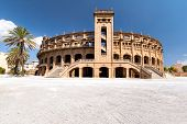 image of bullfighting  - Panorama building for bullfighting in Mallorca on a sunny day - JPG