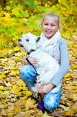 picture of west highland white terrier  - girl with west highland white terrier in the park - JPG
